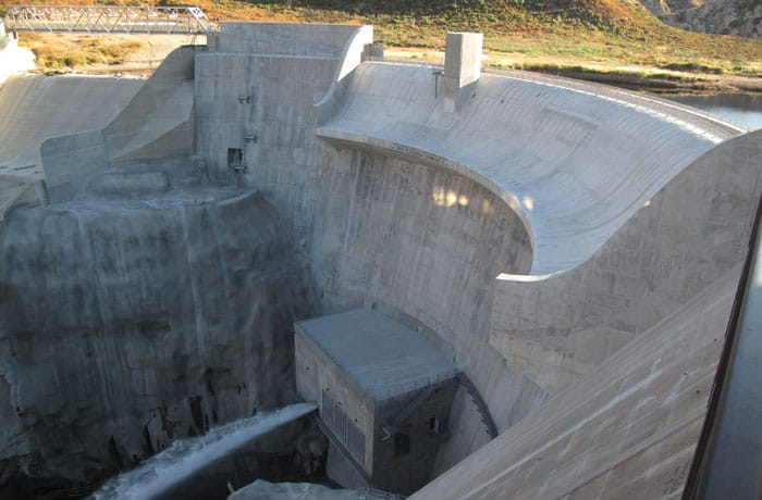 The California Division of Safety of Dams imposed a seismic restriction on the Big Tujunga Dam in 2004 that limited the long-term storage to 1,484 acre/foot. The rehabilitation and spillway modification project, performed by AECOM (legacy Shimmick), restored the dam's original storage capacity to meet the new requirements.