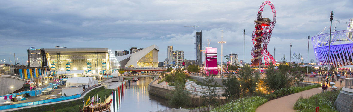 Photo of London's Olympic Park. Clients trust AECOM's planning and consulting services to map the path forward for new development and redevelopment of buildings, campuses, infrastructure, cities and regions.