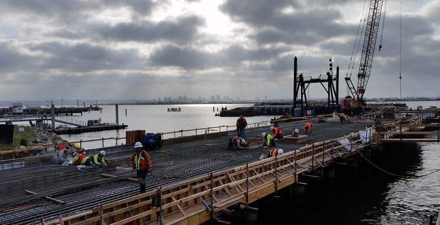 AECOM (legacy Shimmick) performed the Pt. Loma Navy Fuel Pier project, replacing the U.S. Navy's historic fueling pier 180 located at Naval Base Point Loma, San Diego, which has been servicing the fleet since 1907, with a new double-deck steel pile supported T-shaped fueling pier, located in deeper water outboard of the existing structure.