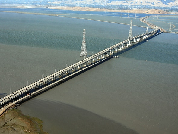 The Dumbarton Bridge, which crosses San Francisco Bay, carries over 81,000 vehicles daily. AECOM (legacy Shimmick Construction) performed a seismic retrofit of the bridge involving its main channel crossing section. During the project, crews raised the bridge 5 inches using 300-ton and 400-ton jacks to allow installation of the steel seismic isolation bearings.